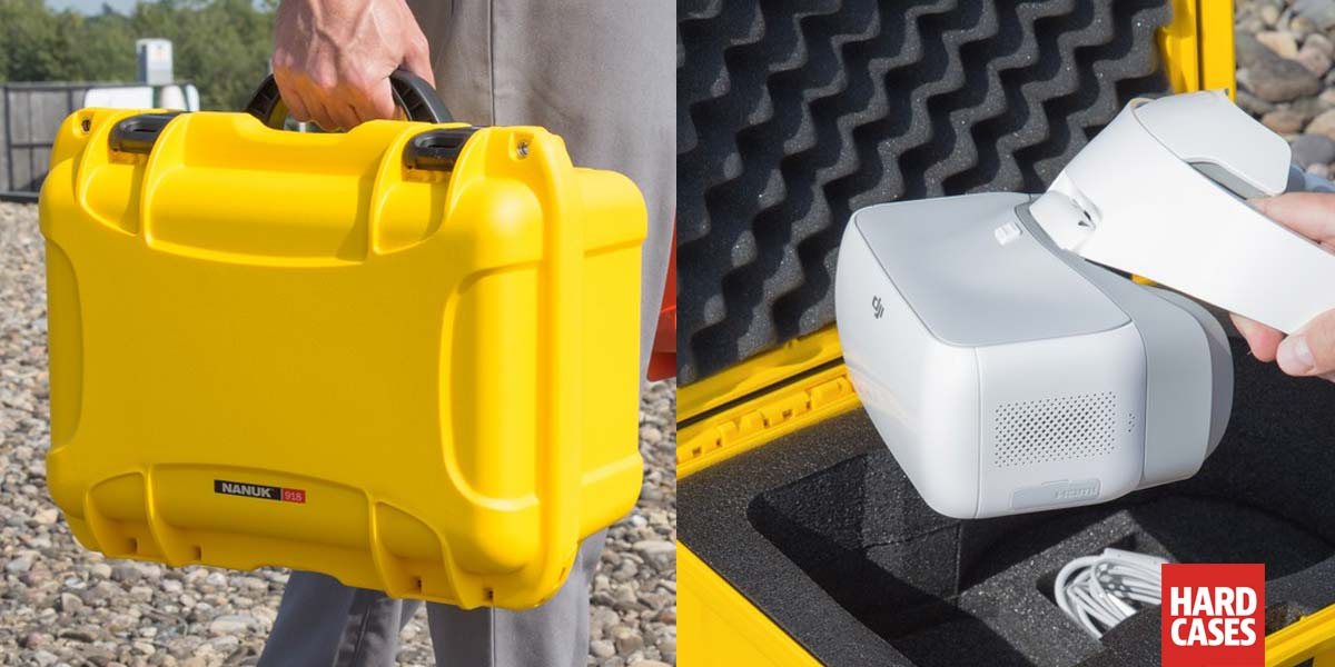 The Nanuk 918 DJI Goggles Hard Case in Yellow in a mans hand and viewed from the top with custom foam