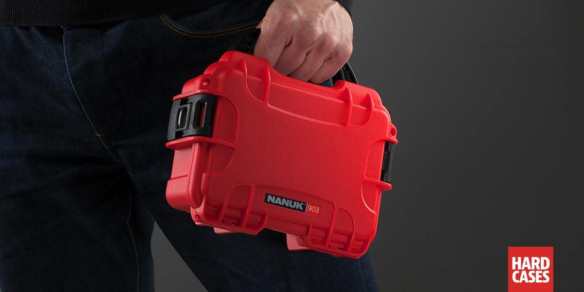 Man holding the Nanuk 903 Red in hand