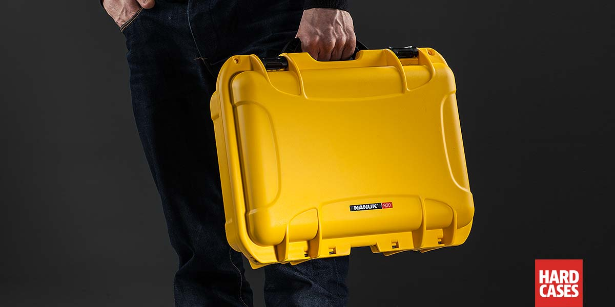 Man holding the Nanuk 920 Hard Case for the DJI Mavic in Yellow in hand